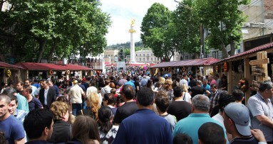 The Rustaveli Avenue was blocked for traffic and crowed by people strolling around and looking to the attractions.